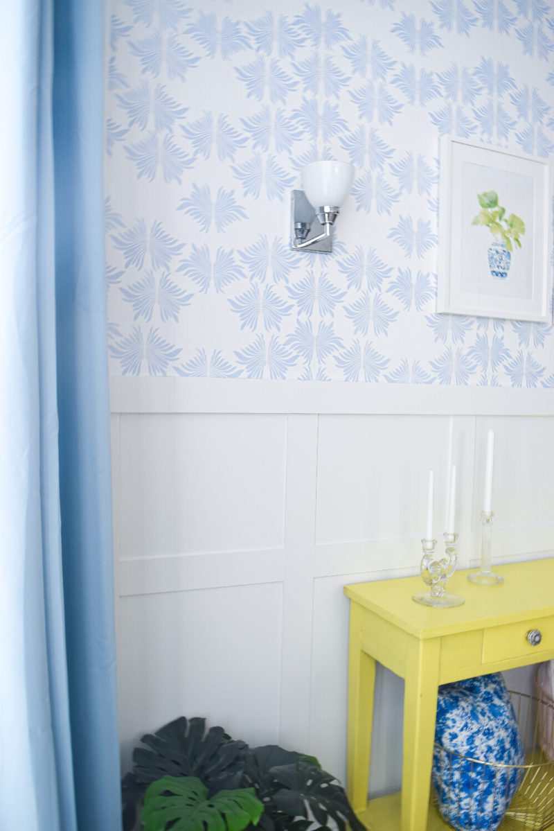 blue and white wallpaper and white board and batten wall