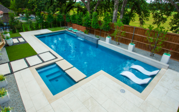 modern pool rectangle shape with in level hot tub tanning ledge and rectangle step pads